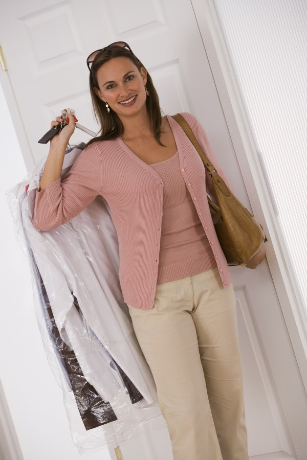 Woman carrying the dry cleaning